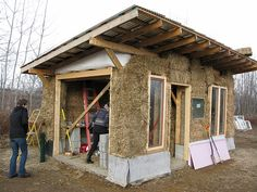 Strawbale cottage. I like the idea of a filled bag built to shape for above door. Easier than what we did.