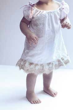 Babie toes and button noses... and whote cotton dresses touched in lace