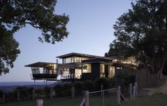 Bark Design Architects has created the distinguished Maleny house which sits on a rolling hill overlooking the Sunshine Coast of Australia.