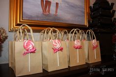 Simple kraft gift bags with suckers attached! Check out the link for the cute party.
