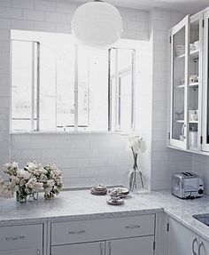 "I selected ""honed carrara marble"" with a white ""subway tile"" backsplash.  Can't wait to see my finished kitchen (6/2012)!"