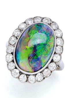 Jewelry Diamond : An Antique Crystal Black Opal and Diamond Ring circa 1920 Centering an oval cry
