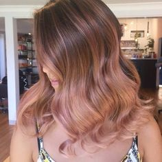 Rose gold hair has been popular for quite some time now, and to be honest we don't see it dying out any time soon. It's still one of the favorite choices among hair color trends of 2018!