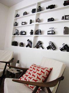 Referencia de display/estante para a coleção de câmeras.