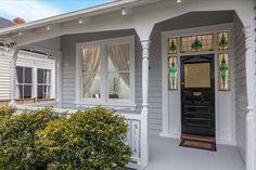 Pretty stained glass front door surrounds at 3 bedroom wooden villa, Herbert Rd, Mt Eden. (For sale @ 2 million NZD, Nov House Paint Exterior, Exterior Paint Colors, Exterior House Colors, Exterior Doors, Front Door Entryway, Glass Front Door, Entrance Doors, Front Doors, Bungalow Porch