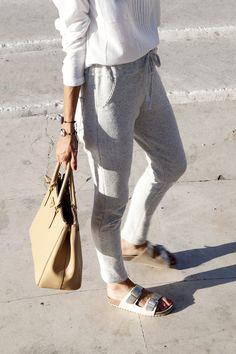 casual and comfortable: slim-leg sweatpants, white blouse, white birkenstocks, purse