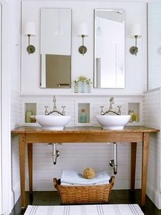 wooden antique table with two vessel sinks and antique bridge-style faucets