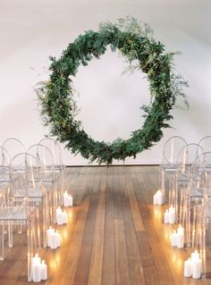 a minimalist Nordic wedding ceremony space with a giant greenery wedding wreath . a minimalist Nordic wedding ceremony space with a giant greenery wedding wreath sheer chairs and candles lining up the a. Wedding Ceremony Ideas, Wedding Altars, Wedding Themes, Wedding Venues, Wedding Arches, Wedding Bride, Diy Wedding, Wedding Bows, Wedding Story