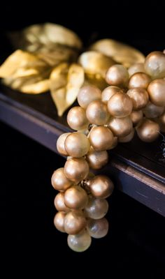 Spray paint dollar store fruit gold for decor at Blue and Gold banquet