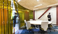 Simple Meeting Room Design With Round Desk Table Plus Green Chairs