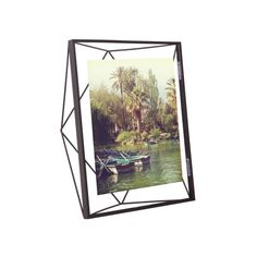 This frame jumps out at you with a structure like an expertly cut gem. Its satiny black finish makes a modern contrast against ceramic and dark wood.  Find the Gem Photo Frame in Black - 8x10, as seen in the Organic Modern Design Collection at http://dotandbo.com/collections/organic-modern-design?utm_source=pinterest&utm_medium=organic&db_sku=90124