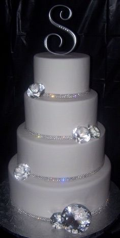 Swarvoski Crystal letters, on plain white cake with crystal border on bottom.