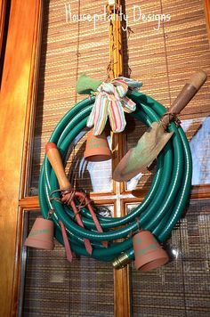 Cute door wreath for the garden shed made from an old hose and tools.  DSC_0214 by shirleystankus, via Flickr
