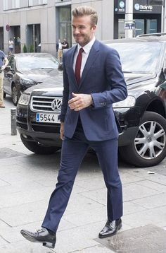 Dapper David Beckham is groomed in Madrid is part of Hipster mens fashion - The sports icon was spotted having a last minute makeup touch up at the launch of the Breitling Boutique in Madrid on Wednesday David Beckham Suit, David Beckham Style, Modern Mens Fashion, Mens Fashion Suits, Terno Slim, Elegant Man, Stylish Men, Dapper, Men Dress