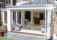 Love the extra nook for the table to allow a seating area infront of doors.Orangery with folding sliding doors Urban Interiors, House Design, Garden Room, Garden Room Extensions, Roof Lantern, Sliding Folding Doors, House, Roof Styles, House Exterior