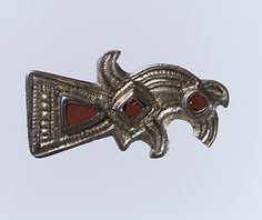 Date: late 6th century Geography: Made in Northern France Culture: Frankish Medium: Silver-gilt, garnets with patterned foil backings; iron spring/pin Dimensions: Overall: 1 7/16 x 13/16 x 3/8 in. (3.6 x 2 x 1 cm) Classification: Metalwork-Silver