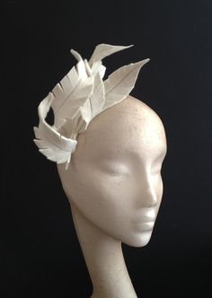 Ivory peachbloom felt feathers with silver stitching, curled round    Can be mounted on a headband or with little loops for Kirby grips so it