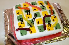A snakes and ladders birthday cake for my 6 year old