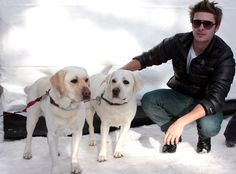 Zac Efron and Two Dogs | What's better than Zac Efron with a dog? Zac Efron with two dogs! We would give anything to be either one of these two pups. And you, the reader, can be the other one. We're generous like that. Susan Etter/INFphoto.com