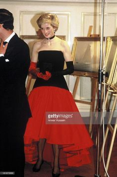 September 19, 1986 Princess Diana attending an America's Cup ball at the Grosvenor House Hotel. Princess Diana upped the ante with a bare décolletage, demure long evening gloves and a tulle skirt designed by Bruce Oldfield