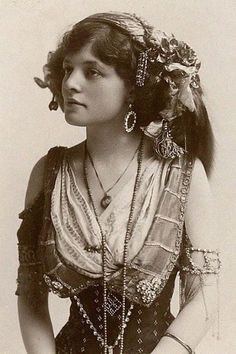 Gipsy-1.3. Looks late 19th century or early 20th, based on the corset and quality of the photo