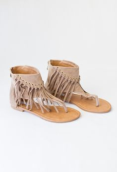 These adorable high rise fringe sandals will be your go to for Summer. Tan is the lighter color. These fit true to size.