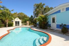 Relax by the heated pool at the #Honeyfish villa on #AnnaMariaIsland