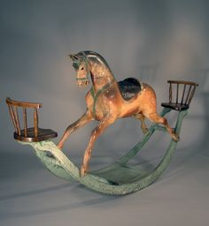 *ROCKING HORSE ~ the most amazing + wonderful rocking horse w/ a small childs oak spindleback chair at both ends of the pale blue rocker. The horse sports a padded + paint embellished saddle w/ a green bridle + harness + wonderful glass eyes. Antique Rare, Antique Toys, Vintage Antiques, Antique Rocking Horse, Vintage Horse, Rocking Horses, Toy Art, Objets Antiques, Wooden Horse