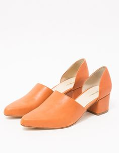 Slip-on heel from Intentionally Blank in Orange. Pointed toe. Concealed elastic goring at inside vamp. Leather lining. Padded footbed. Leather-wrapped block heel with rubber cap. • Leather upper • Leather sole • Women's sizes listed