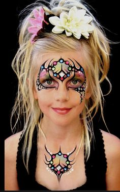 Jeweled tribal mask. face painting.