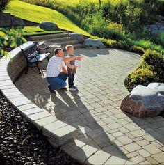 RomanPisa walls and Roman pavers make for this wonderful patio.