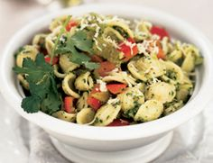 For a change of pace, try this pasta dish with a Southwestern sensibility. You can also use the cilantro pesto as a condiment for grilled vegetables or thin it Vegetarian Times, Vegetarian Main Dishes, Vegetarian Recipes, Healthy Recipes, Healthy Dinners, Pesto Pasta Recipes, Pesto Recipe, Red Pepper Recipes, Cilantro Pesto