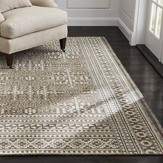 Tolliver squares up the curved flourishes of traditional oriental rug design in graphic order while retaining the motif's intricate appeal. Each rug is hand knotted with a silky blend of cotton, wool and rayon yarns in room-pleasing light latte brown and tonal neutrals.