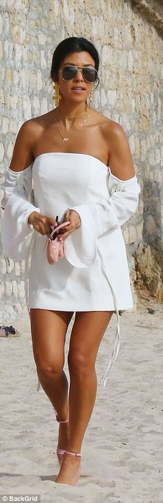 Stylish: While Kourtney's thigh-grazing number put her slender pins on display, Kendall co...