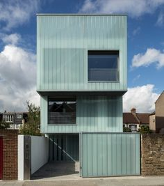 """Residential Architecture: Slip House by Carl Turner Architects: """"..Occupying one of four plots forming a gap in a typical Brixton, London, England, terrace, Slip House constitutes a new prototype for adaptable terraced housing. Three simple 'slipped' orthogonal box forms break up the bulk of the building and give it it's striking sculptural quality..The top floor is clad in milky, translucent glass planks, which continue past the roof deck to create a high level 'sky garden'."""