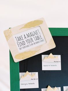 Emerald and gold magnetic escort board. Love this Idea_ Seating cards and gifts in one