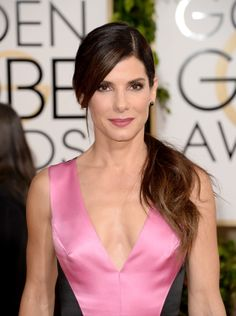 Sandra Bullock with a sideswept ponytail at the Golden Globes
