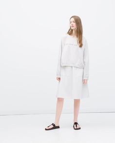 ZARA - SALE - SWEATSHIRT WITH TEXT DESIGN http://www.zara.com/us/en/sale/woman/starting-from-50-off/tops/sweatshirt-with-text-design-c706721p2486551.html