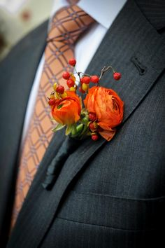 orange boutonniere by Just Priceless. Image by Photo Innovations