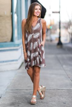 """""""Floating Feathers Dress, Toffee""""This jersey knit dress is super light and spot on for spring or summer! The feather print is pretty awesome too! #newarrivals #shopthemint"""