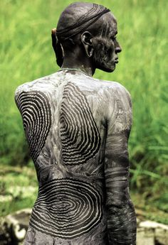 "Africa | Painted Surma man; in a society where adornment and clothing are minimal, body painting serves an important form of creative expression.  Ethiopia, 1986. | ©Carol Beckwith & Angela Fisher. Publication ""African Ceremonies"""
