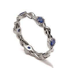 Braided Eternity Ring - 14K White Gold and Sapphire engagement ring, celtic ring, engagement ring, Sapphire Eternity ring, Blue Sapphire, 2E by DORONMERAVCLASSICS on Etsy https://www.etsy.com/listing/241149126/braided-eternity-ring-14k-white-gold-and