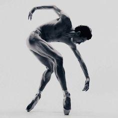 Male ballerina en pointe. Lighting to accentuate musculature.