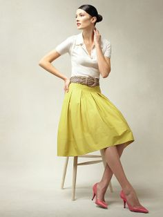 polo sweater, pleated swing skirt, braided leather belt