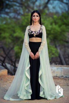Shop Prathyusha Garimella - Black lehenga set with mint green cape Latest Collection Available at Aza Fashions Indian Gowns Dresses, Indian Fashion Dresses, Indian Designer Outfits, Designer Dresses, Fashion Suits, Cape Lehenga, Black Lehenga, Anarkali, Lehenga Choli