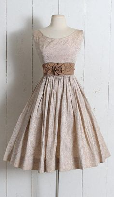 "➳ Vintage 1950s Dress Stunning champagne brocade 1950s dress. Shimmery rosebud embossed print, rosette waist, metal back zipper. Excellent condition - no flaws. Fits like XS/S. Length 40"" Bodice 15"" Bust 36"" Waist 26"" 2"" bodice allowance 3"" hem allowance ➳ shop"