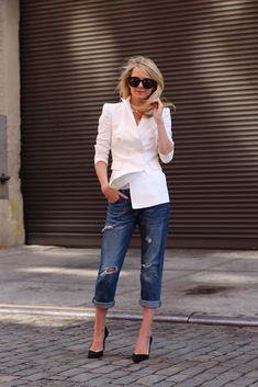 boyfriend jeans and white blazer.