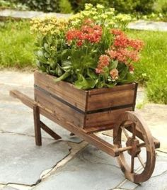 "Design by a2zdesignstore Search Ebay Store Home View all listings Add to favourite Feedback Contacts Wooden Wheelbarrow Planter Product Details Brand new, Factory sealed box Wooden Wheelbarrow Planter Great Price & FREE Shipping! This Wooden Wheelbarrow Planter made of genuine wood adds an excellent decorative aspect to your outdoor. This planters antique look will add a great personal touch where ever you display it. Genuine wood For outdoor use Dimensions: 41.25"" L x 12.75"" W x 14.5 "" H…"