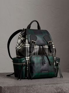 Our Burberry signature rucksack created from laminated Scottish-woven wool  in clashing tartans. The dab17021a9672