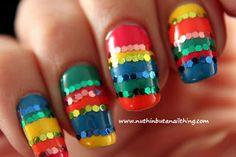 Rainbow glitter manicure...